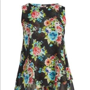 Floral multi color black sleeveless tunic .
